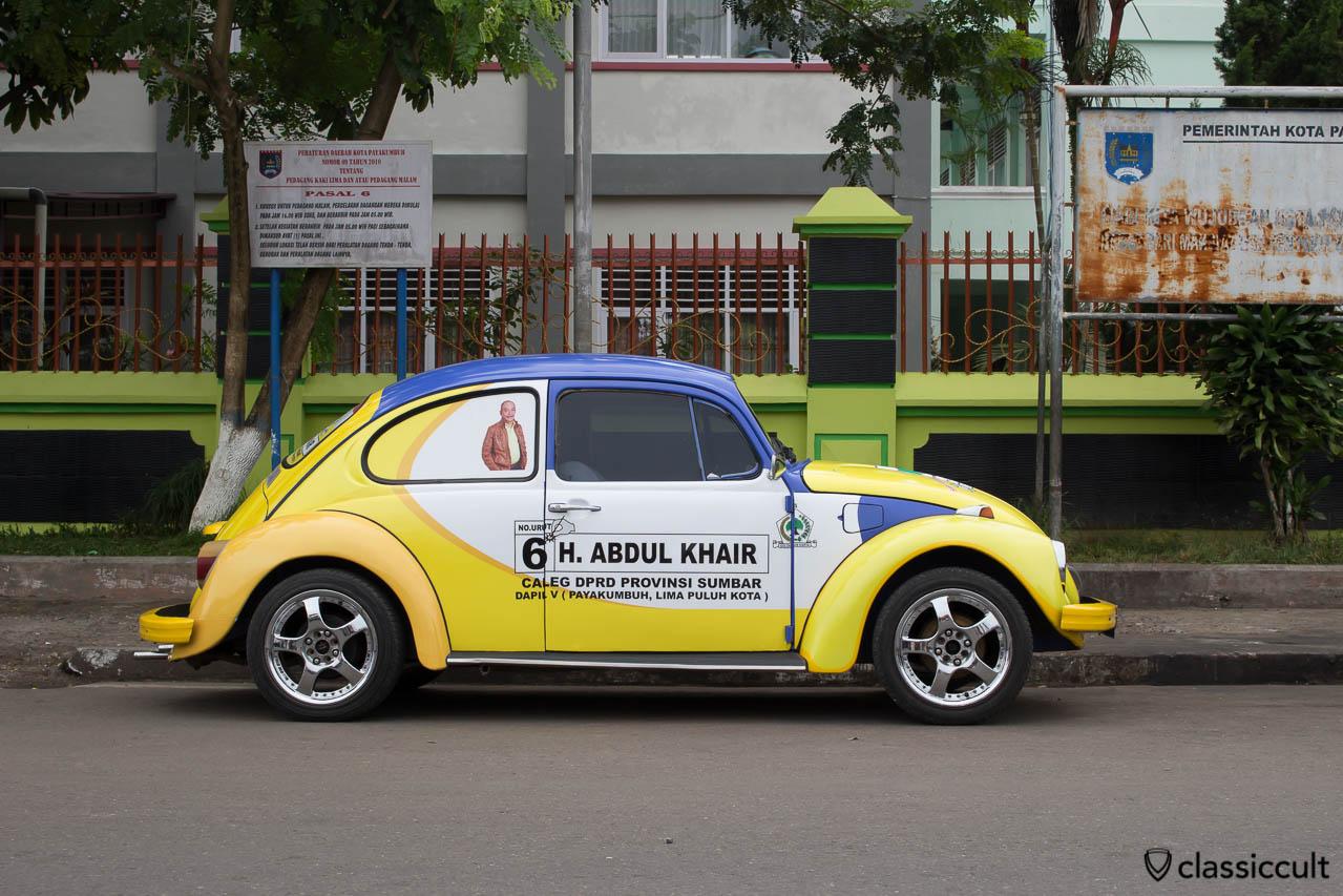 VW Bug with advertisement of the Indonesian Partai Golongan Karya in Payakumbuh Sumatra Indonesia.