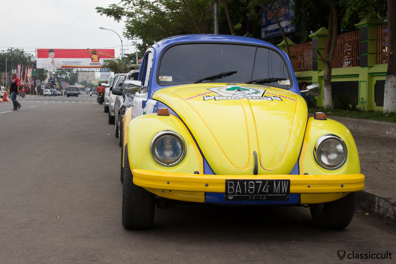 VW Bug with advertisement of the Indonesian Partai Golongan Karya in Payakumbuh Sumatra Indonesia.