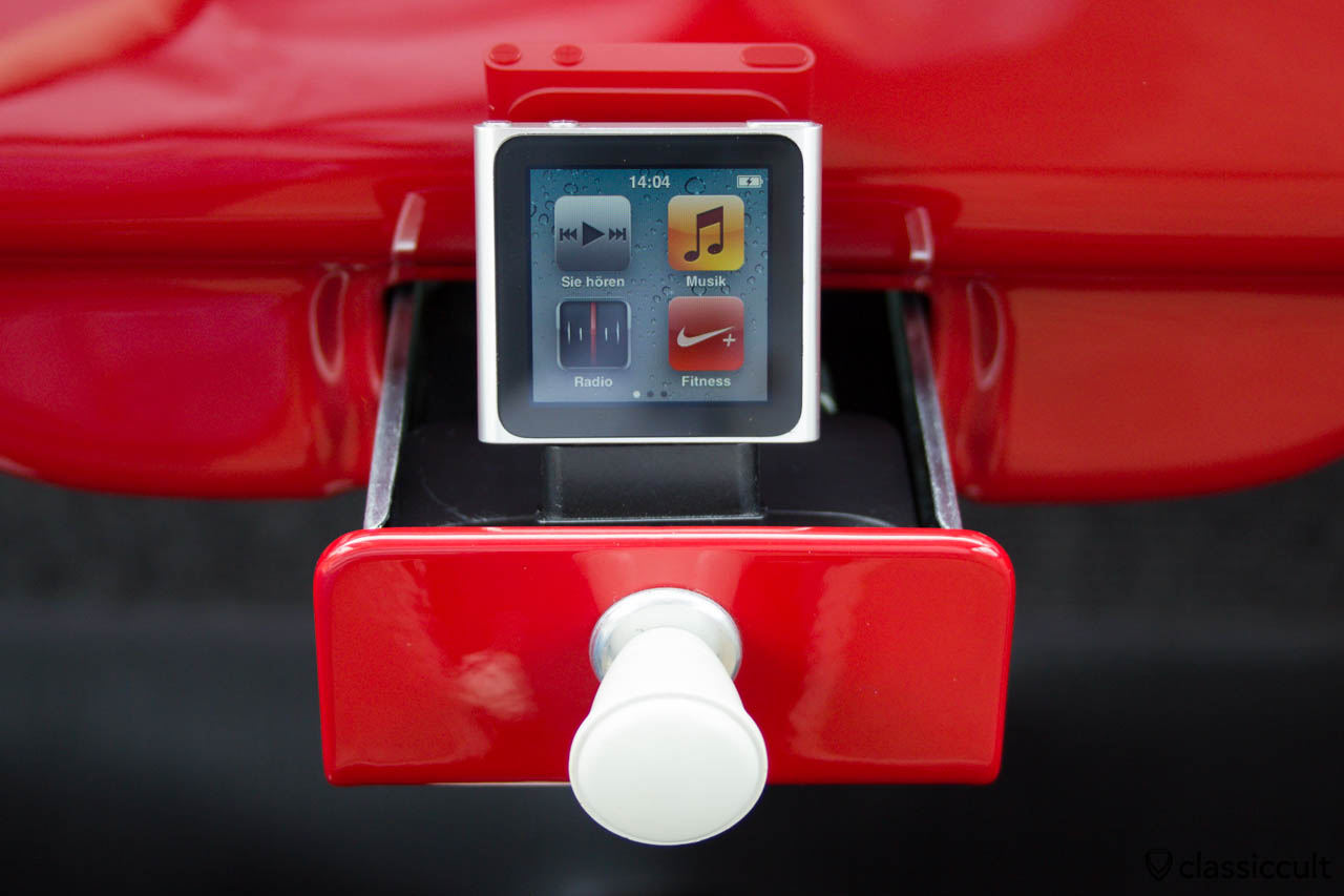 VW Bug ashtray with iPod touch nano 6th generation charging in the docking station.