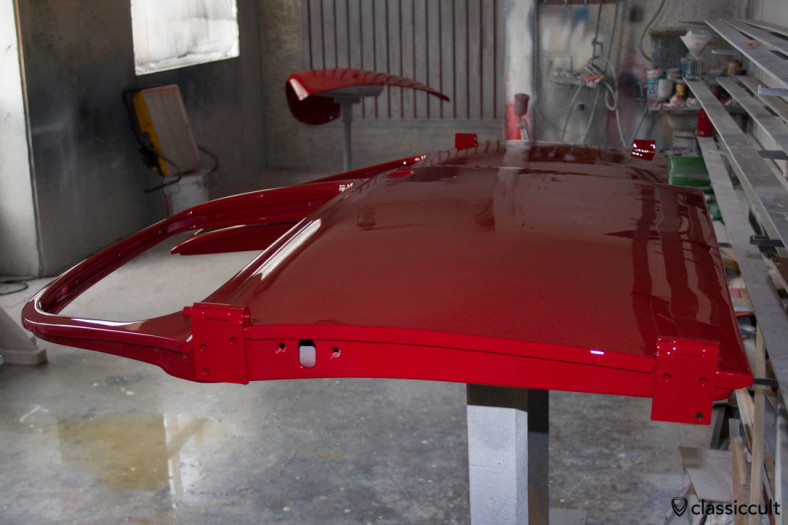 VW Bug door painted in ruby red.