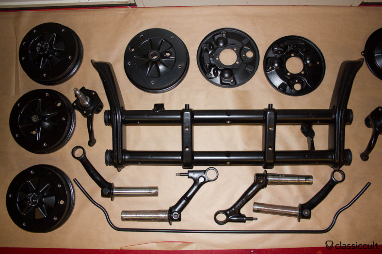 VW Beetle restoration front axle and brake drums black painted.