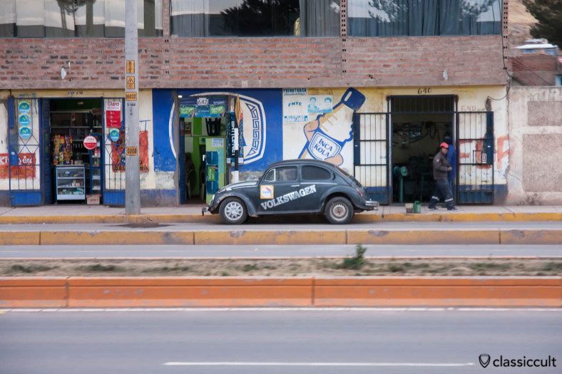 VW Bug and Inca Kola Advertisement seen from Andean Explorer, Peru, May 15, 2013