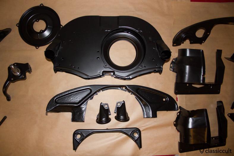 VW Bug motor paneling black painted.