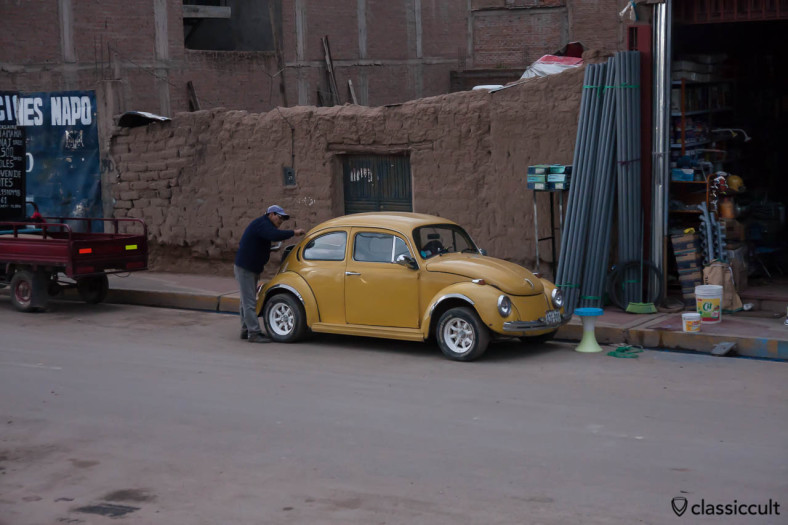 VW Bug with tuned trunk seen from Cuzco to Puno train, Peru, May 15, 2013