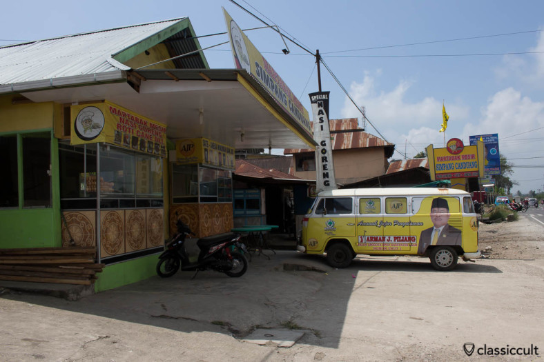 VW Bay Bus with advertisement of the Indonesian Party Golongan Karya in Payakumbuh Sumatra Indonesia.