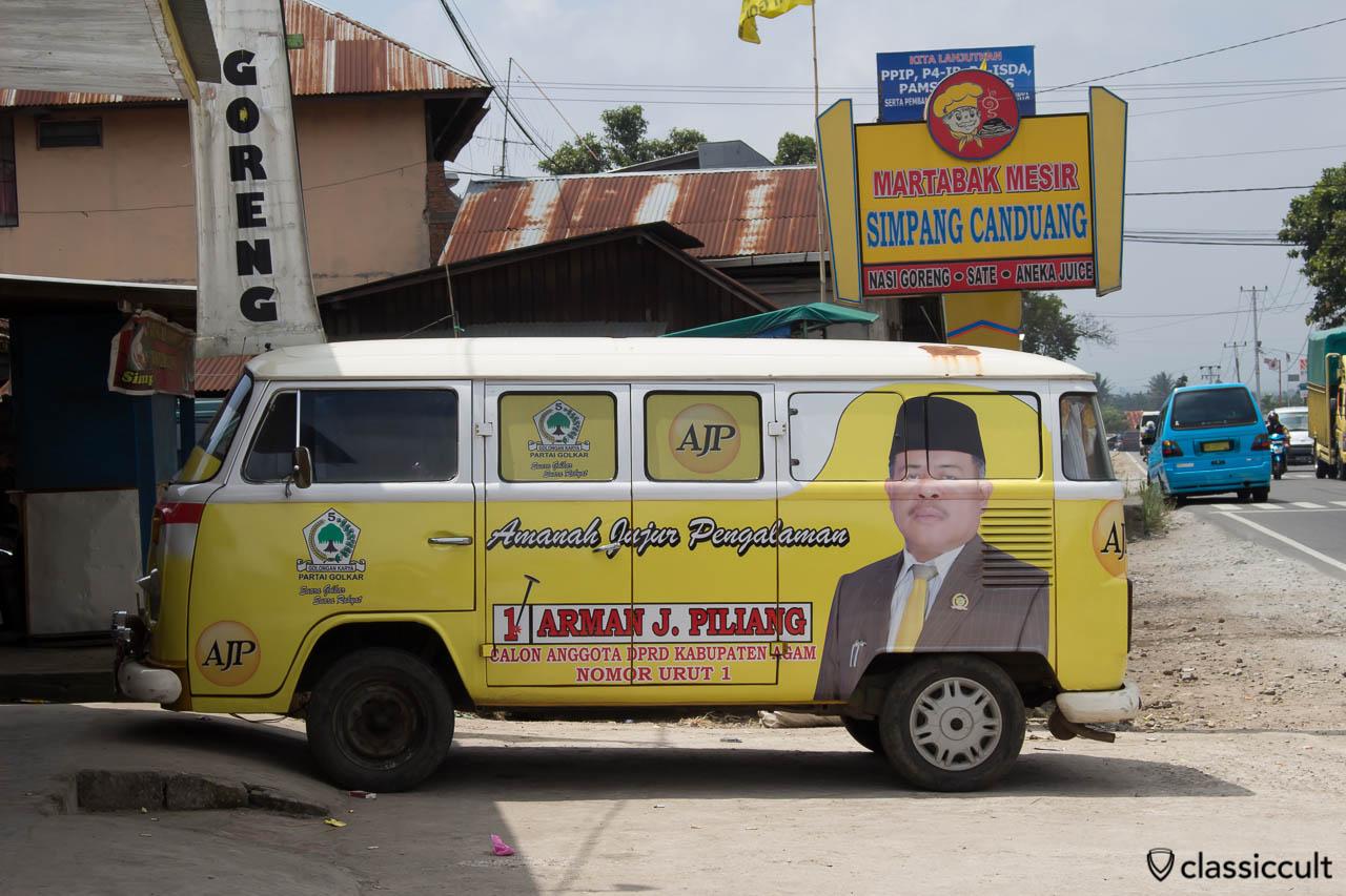 VW Bay Bus with advertisement of the Indonesian Party Golongan Karya in Payakumbuh Sumatra Indonesia.