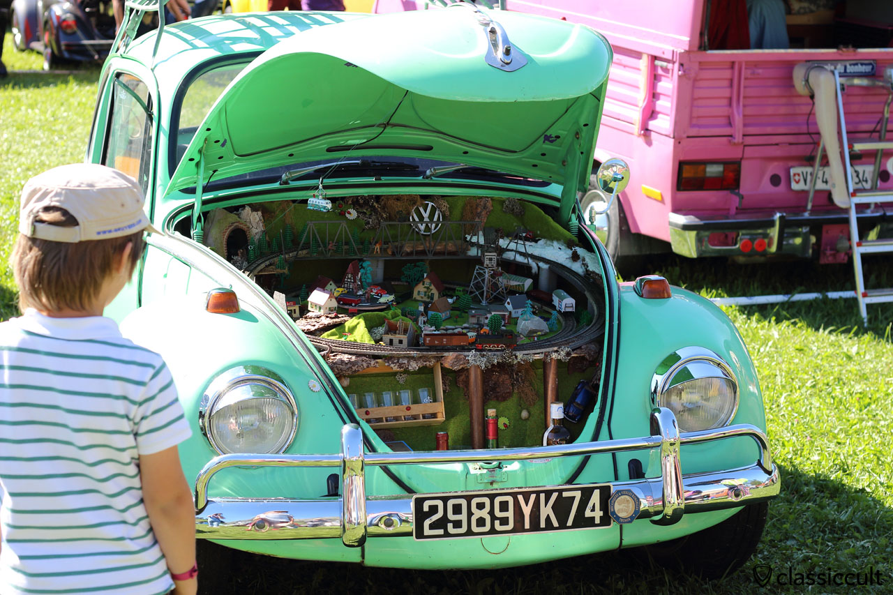 VW Beetle with toy train under the hood