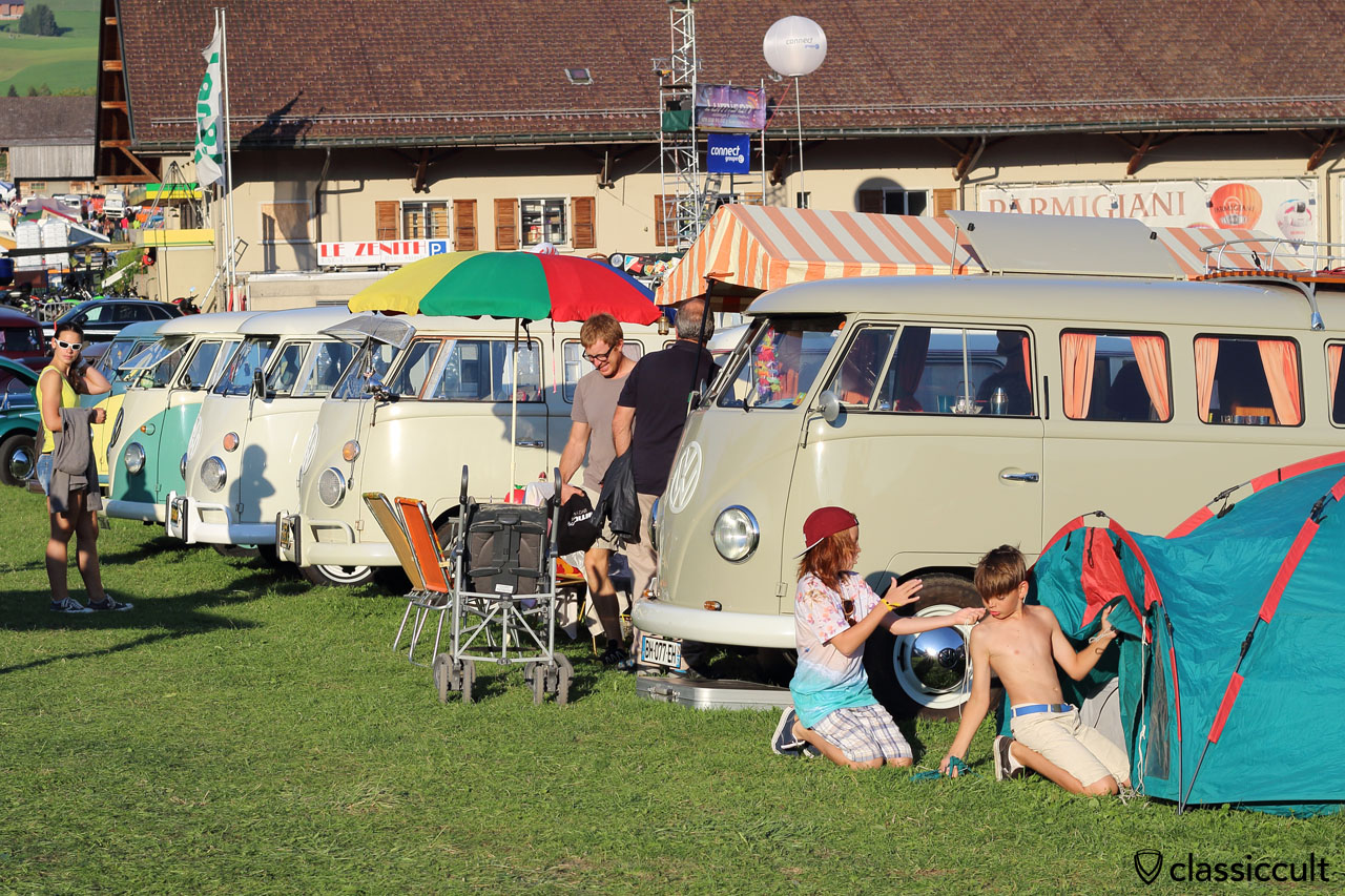 VW T1 Show & Shine and kids setting up a tent for the night, 6:39 p.m., Château-d'Oex VW Meeting 2015
