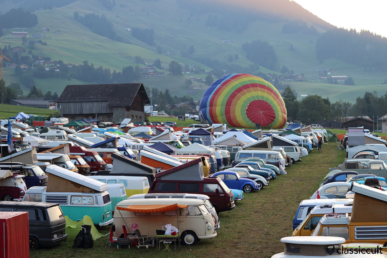 Good morning Château-d'Oex VW Meeting, Sunday 30th August 2015, 7:07 a.m., hot air balloon getting ready to take off, bug most VW fans are still seeping in a VW Camper Van or tent