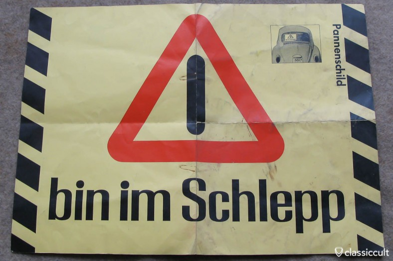 """Vintage german """"will be towed"""" sign. This should be mounted on the rear window of the Volkswagen with the breakdown."""