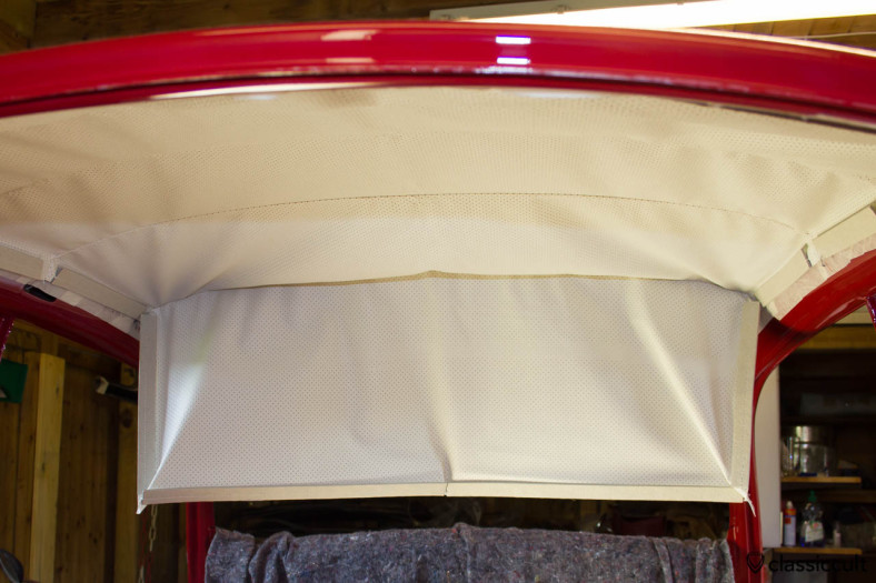 VW Standard Beetle Headliner installation. The next step is to put the headliner with the original rods in place. Start at the rear and work forward. You need lots of power to get the headliner in place.