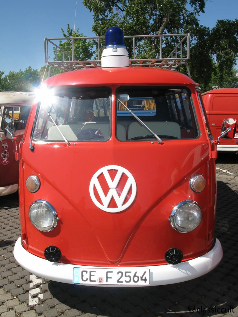 VW T1 Fire Department Bus with blue emergency light and horns.