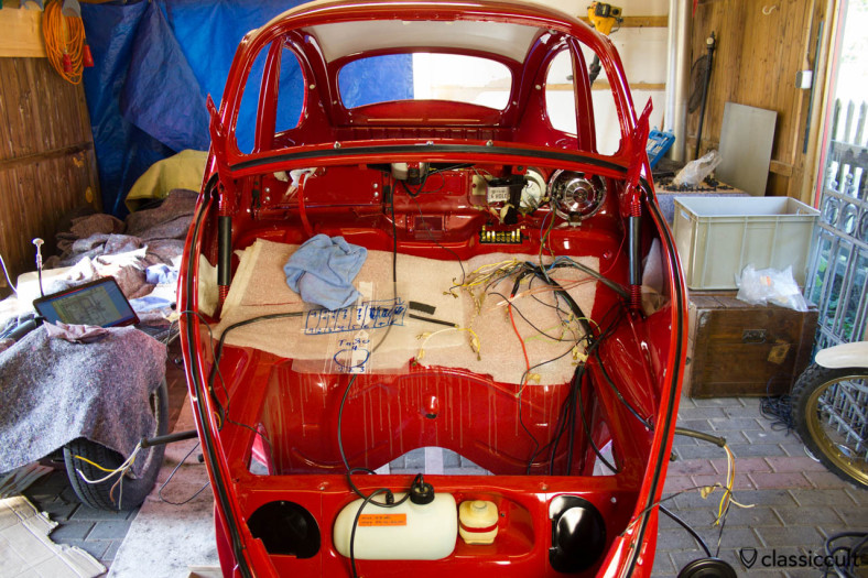 VW Beetle restoration wiring the original harness. I did as much as possible of the wiring before the hood, tank and floor pan was mounted. On my first beetle restoration I mounted the floor pan and hood before I did the wiring and it was much more exhausting for my back. I would recommend to do the wiring first. It is very comfortable to stand at the place where the tank goes in and do the wiring.